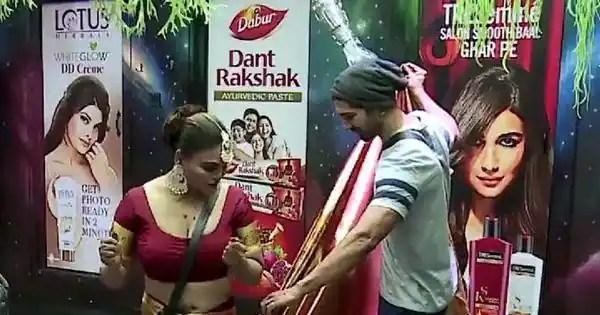 'Arey Abhinav Shukla tuck in to karo,' Rakhi Sawant asks Rubina Dilaik's husband as he drapes her saree
