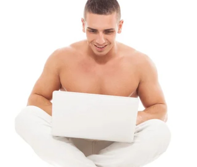 Man With Nacked Chest Is Working With Notebook Stock Photo