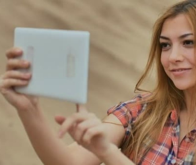 Sexy Girl Selfie With The Tablet On The Sand In Desert Slow Motion Outdoors Stock