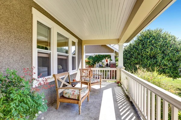 front covered porch with outdoor furniture stock images page everypixel