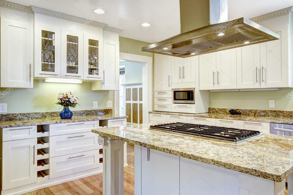 kitchen island with built in stove granite top and hood stock photo image by c iriana88w 52760047