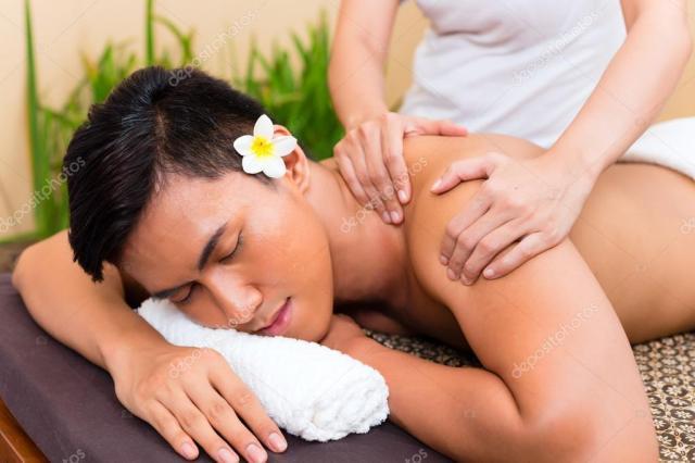 Indonesian Asian Man At Wellness Massage Stock Photo