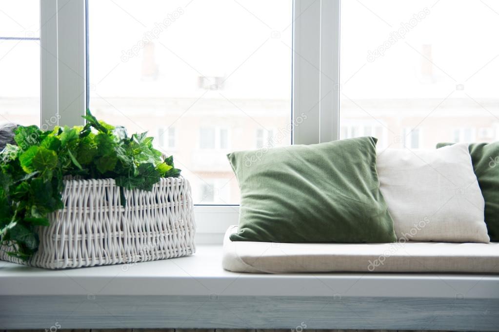 pillows on the windowsill and plastic window stock photo image by c kanzefar 70882673