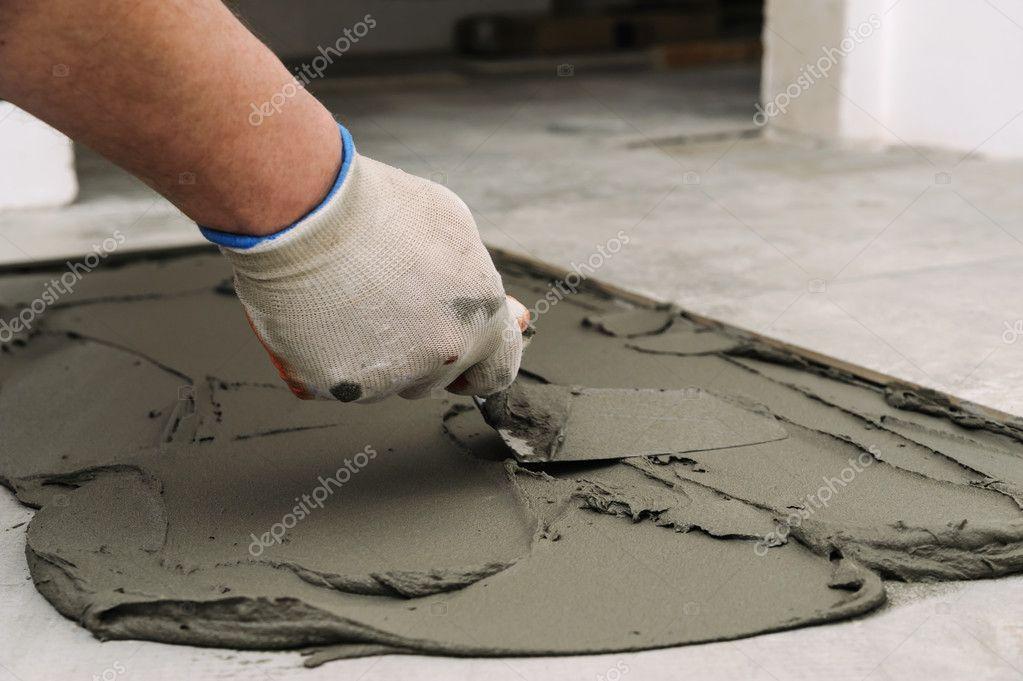 https depositphotos com 101665456 stock photo laying ceramic tiles troweling mortar html