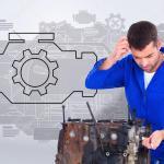 Confused Mechanic Repairing Car Engine Stock Photo Wavebreakmedia 76142911