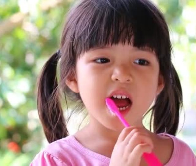 Cute Asian Girl Brushing Teeth No Toothpaste Stock Video