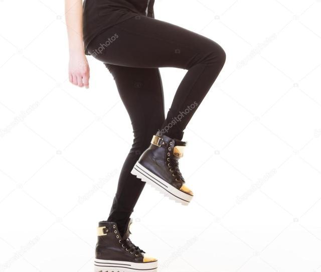 Teen Fashion Female Legs In Sneakers Stock Photo