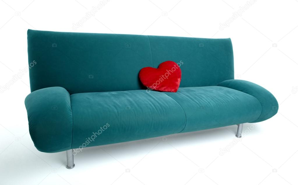 canape avec coussin en forme de coeur rouge photo