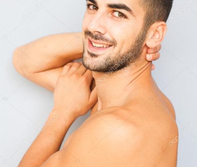 Handsome Man Half Naked On White Background Stock Photo