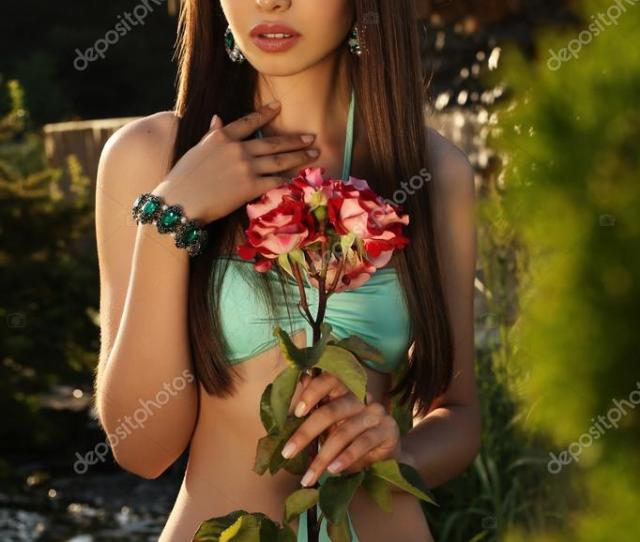 Beautiful Tanned Girl With Dark Hair In Elegant Swimsuit Stock Photo