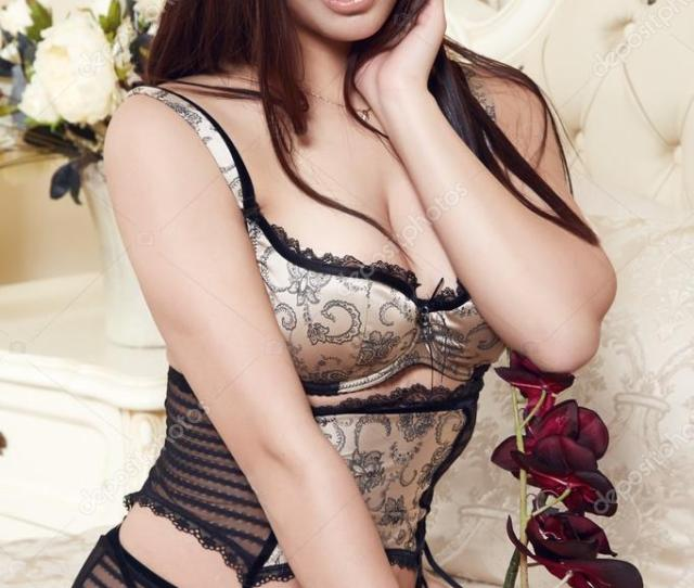 Beautiful Sexy Long Haired Brunette Woman Sitting On A Bed With Pillows In Lace Lingerie Silk Linens Flower Evening Makeup Perfect Body Shape Photo By