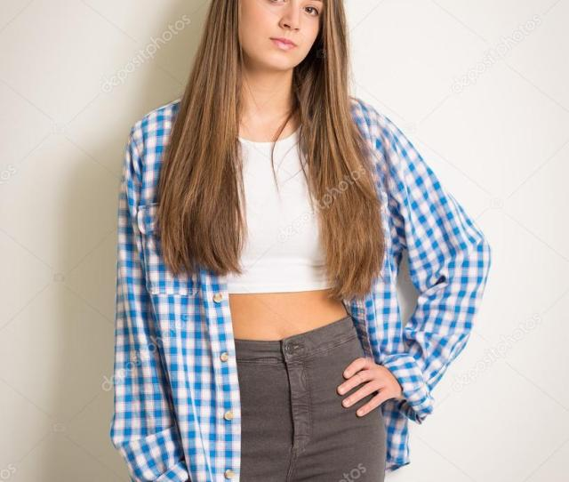 Beautiful Teen Girl In A White Top And Blue Shirt Stock Photo