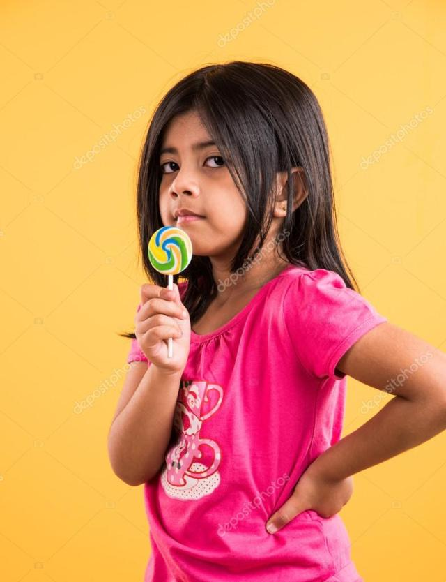 Indian Small Girl With Lolipop Or Loly Pop Asian Girl And Lolipop Or Lolypop Playful Indian Cute Girl Posing With Lolipop Or Candy Photo By Subodhsathe