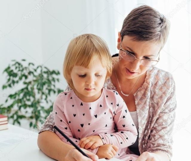 Mom Teaches Daughter To Write Stock Photo