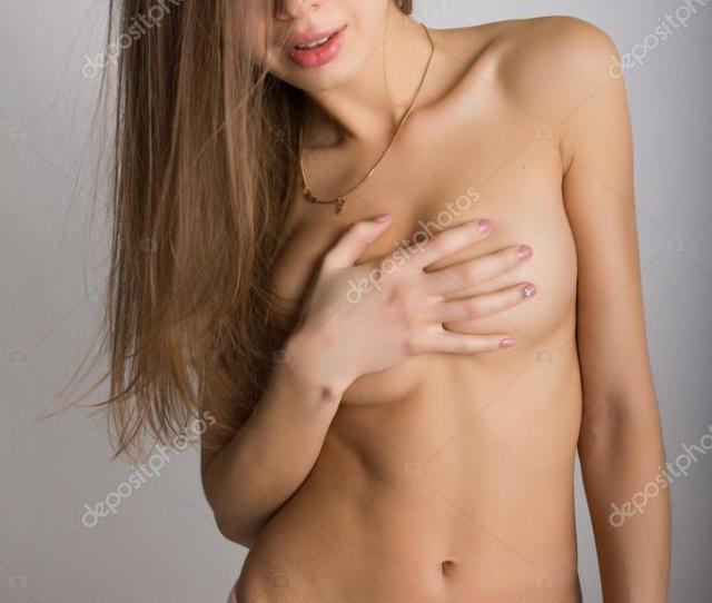 Sexy Blonde Girl In Pink Shorts Covers Her Naked Breasts With Her Hands Stock Photo