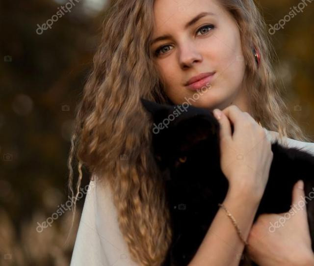 Beautiful Happy Smiling Blonde Girl Hold Black Cat In Hands Cute Girl With Long Curly Hair Hug Little Small Black Cat Cute Friendly Kind Girl Love