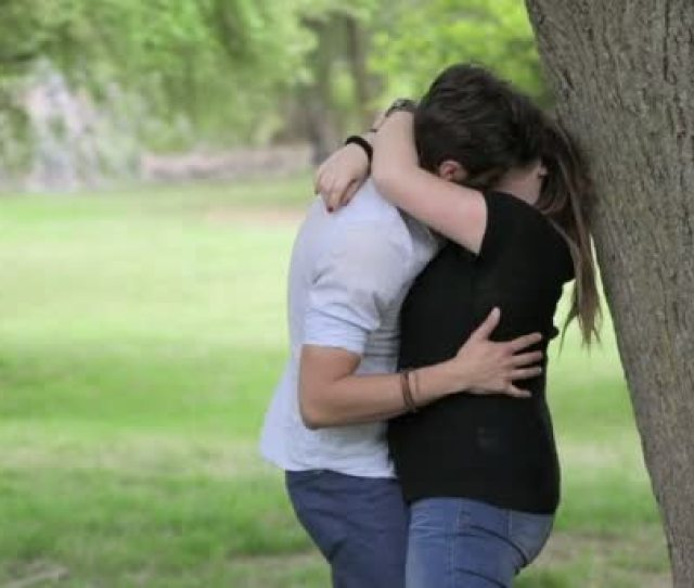 Man And Woman Passionate Kissing In A Public Park Couple In Love Stock Footage