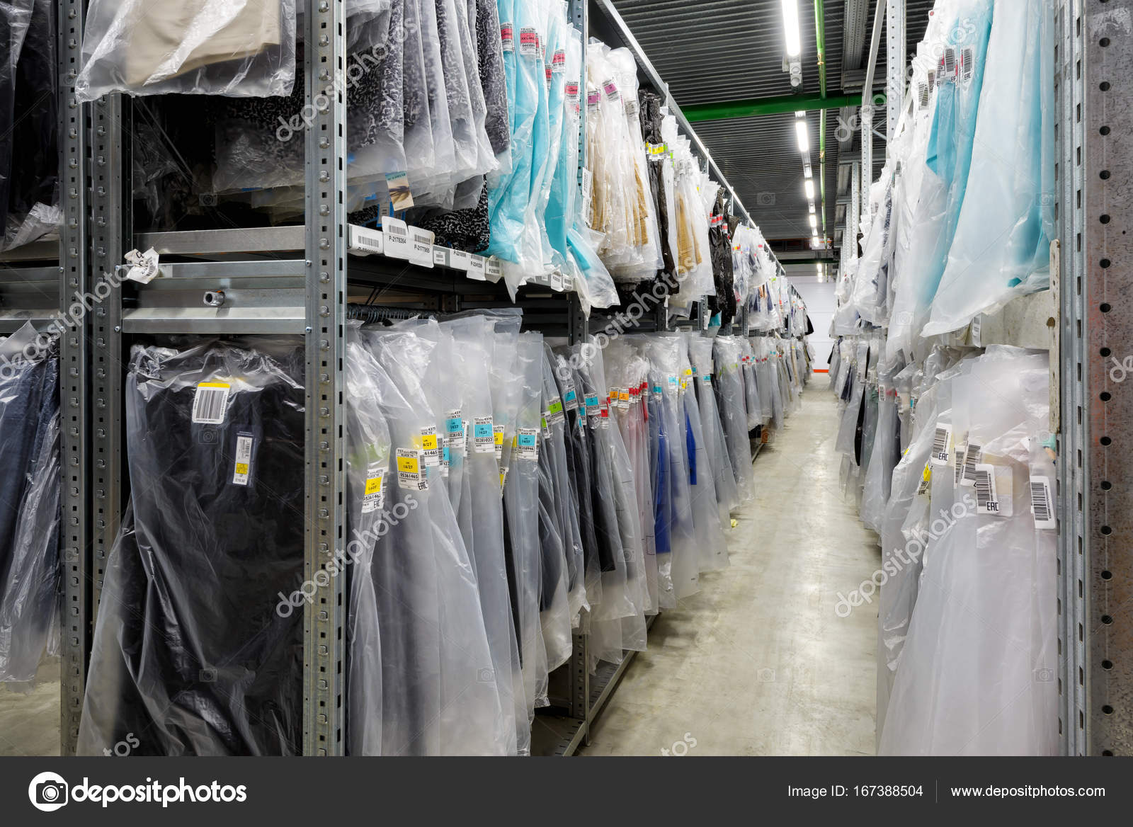 clothes are hanging in the large warehouse stock editorial photo c scaliger 167388504