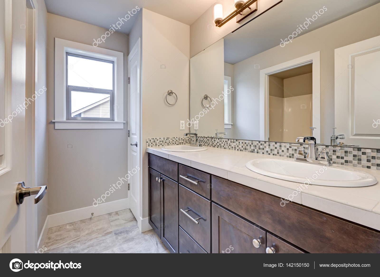 new light bathroom interior with double sink dark wood bathroom vanity stock photo image by c iriana88w 142150150