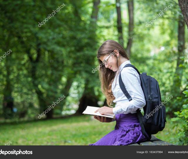 Pretty Little Blonde Schoolgirl With Backpack And Long Hair Sitt Stock Photo