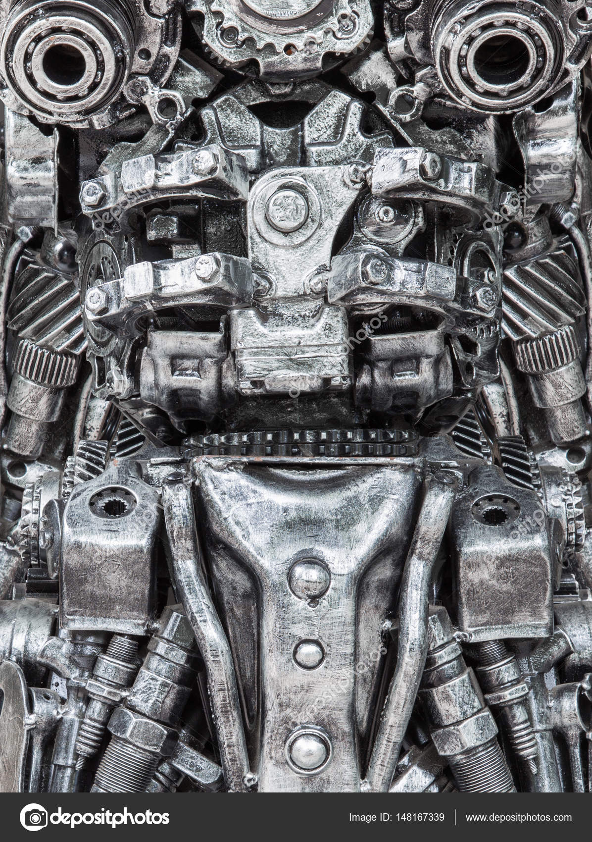 Closeup Body Of Metallic Robot Made From Auto Parts With