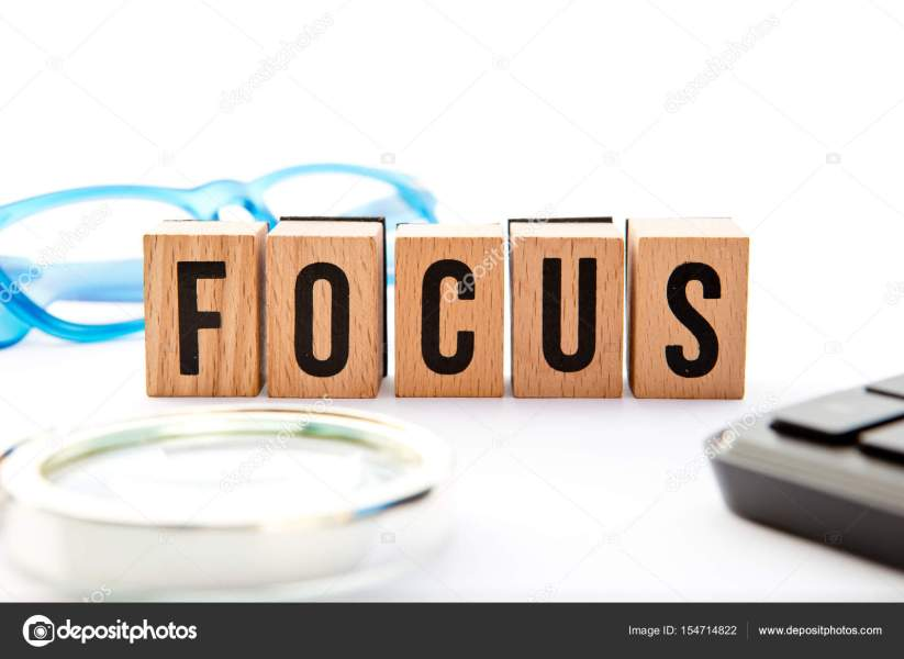 Focus   wooden block letters with keyboard  glasses and magnifying     Focus   wooden block letters with keyboard  glasses and magnifying glass      Stock Photo