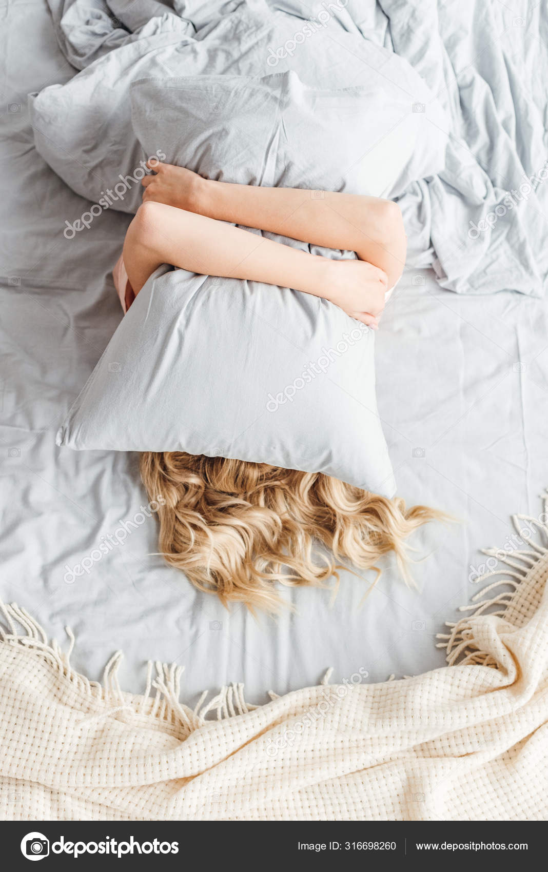 top view woman covering face pillow bedroom stock photo image by c vitalikradko 316698260