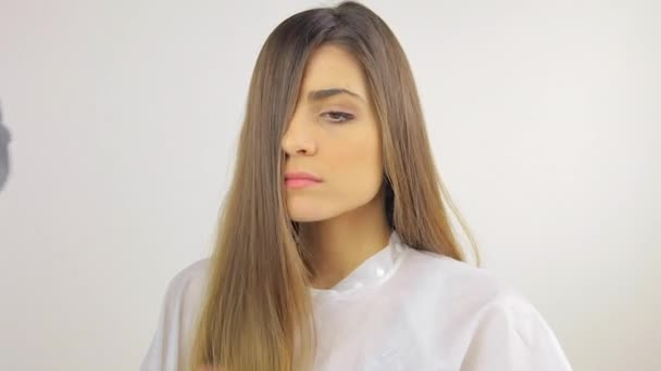 Image Of A Woman Looking Unsure While Getting Fringe Cut