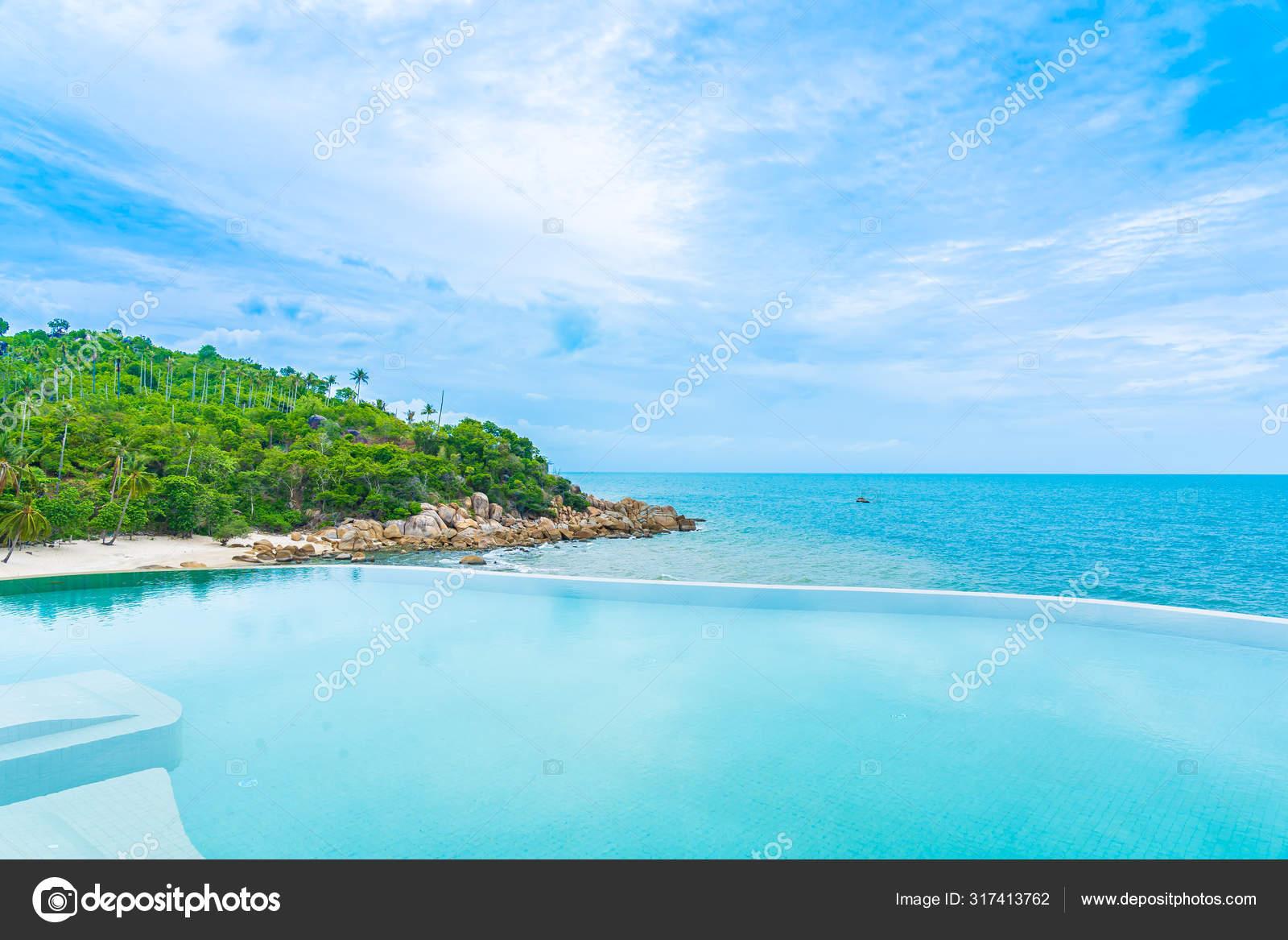 Beautiful Outdoor Infinity Swimming Pool In Hotel Resort With Se Stock Photo C Mrsiraphol 317413762