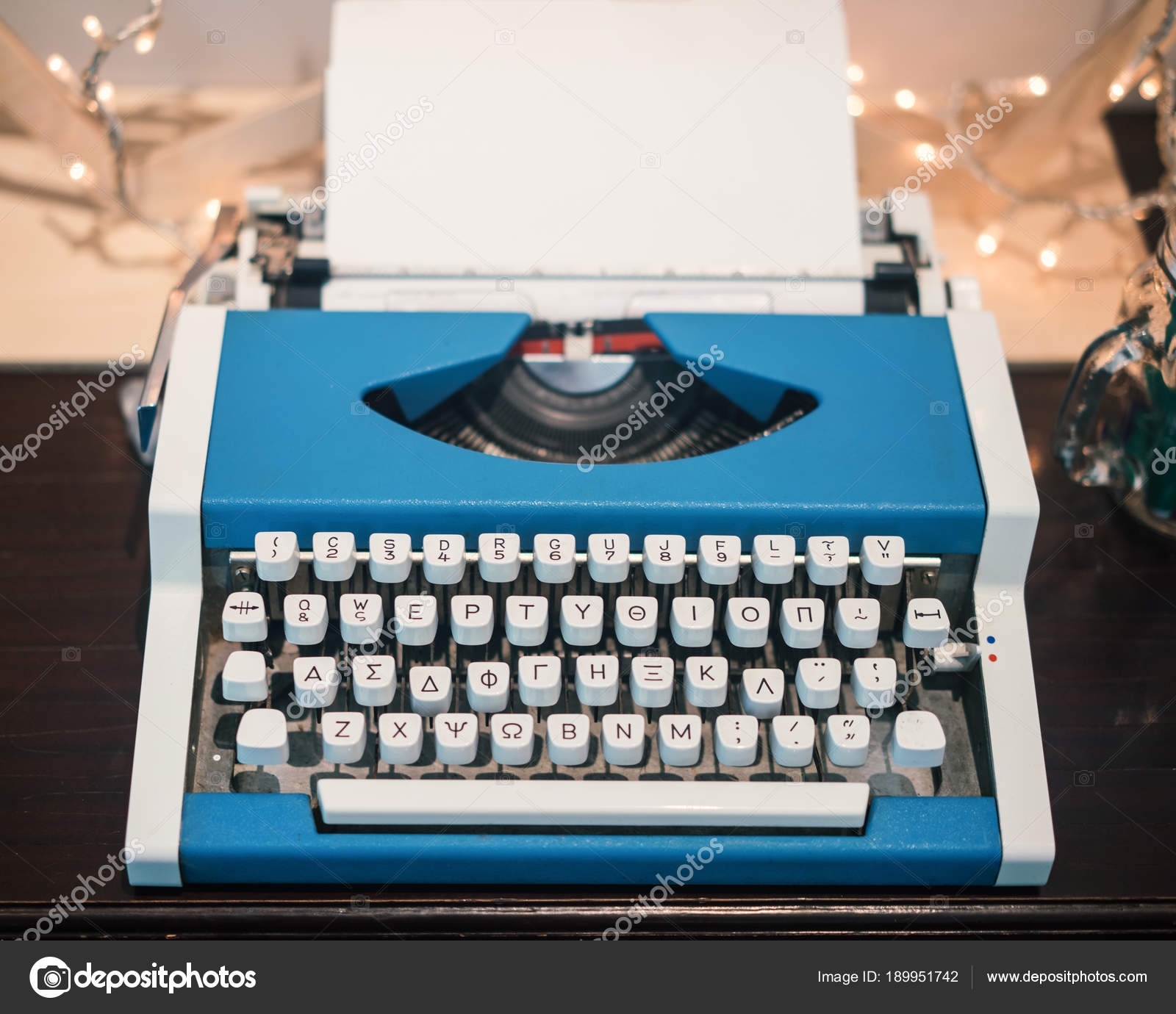 Old Typing Machine With Blank White Sheet And Greek
