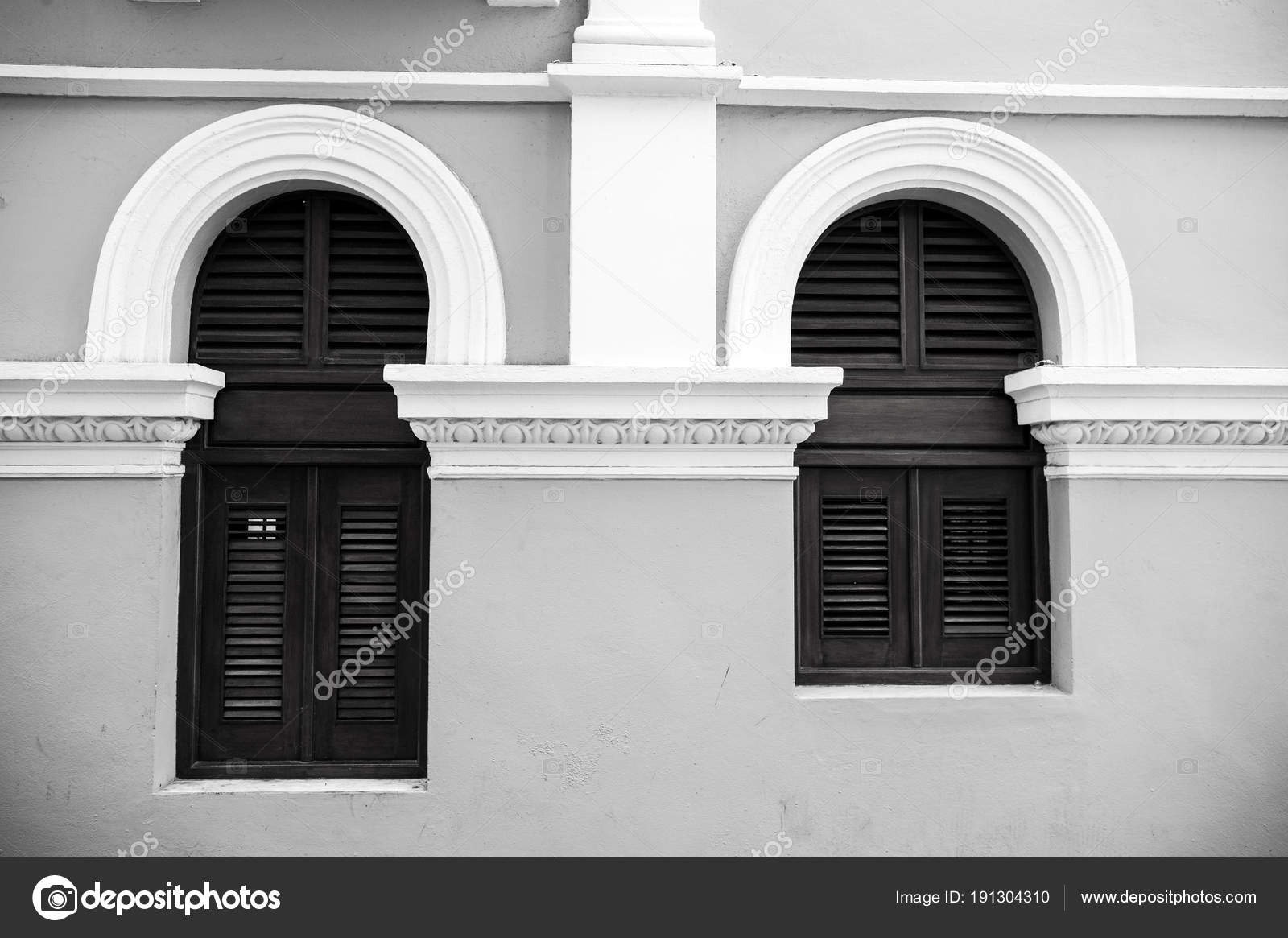 Big And Small Windows With Wooden Shutters In Puerto Rico