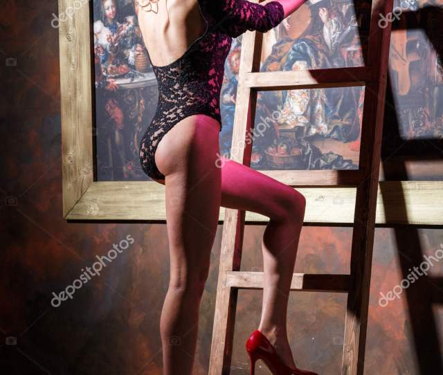 Beautiful Young Woman In Black Lingerie Standing Near Ladder Placed Over Big Painting On Wall Photo By Schummyone