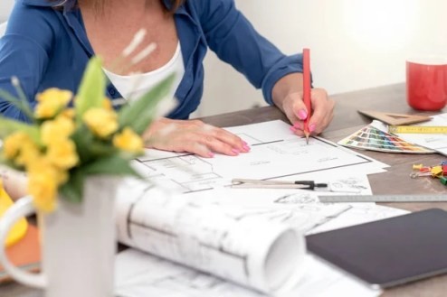 Architect working on plans — Stock Photo