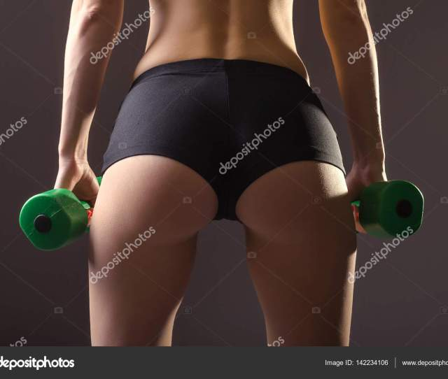 Womens Ass In Black Shorts On A Gray Background Stock Photo
