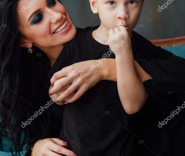 Beautiful Brunette Mom Hugging Her Son Lying On The Sofa Family Mother And Her Cute Boy Black Clothes Stock Image