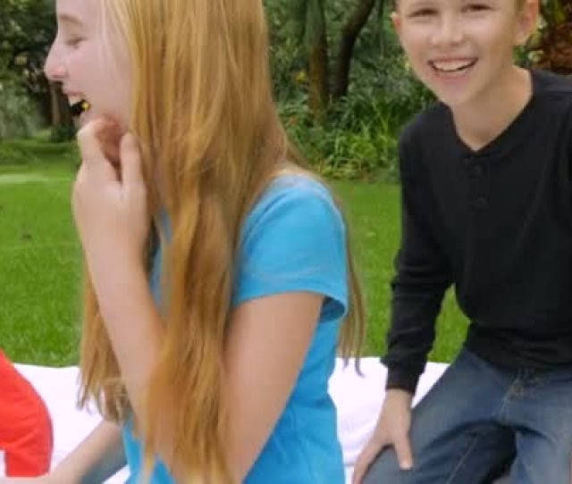 A Younger Brother And Older Sister Wrestle Playfully And Laughing Slowmo Stock Footage