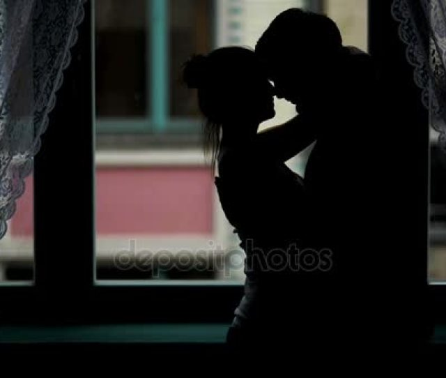 Erotic Silhouette Of Lovers In The Darkness Romantic Woman And Man Are Hugging And Kissing