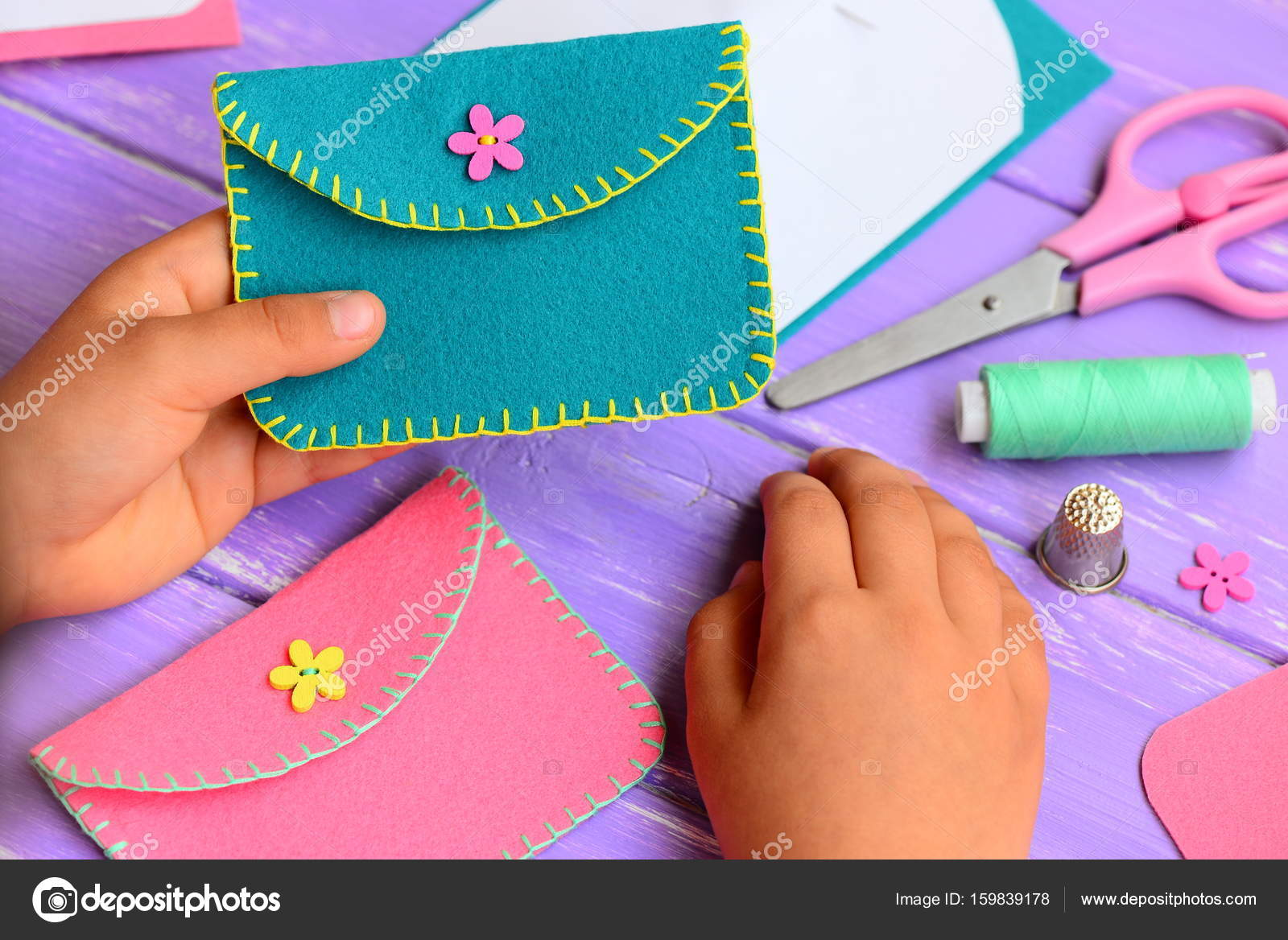 Small Child Holds A Felt Purse In His Hand Child Shows A