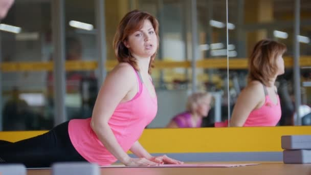 Adult Mature Women Stretching Out In Fitness Room Yoga Training Stock Video