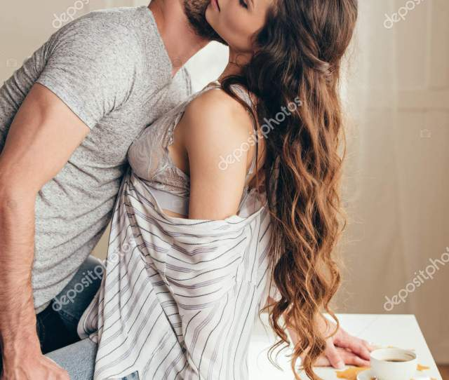 Man Kissing Passionate Girl In Foreplay Stock Photo