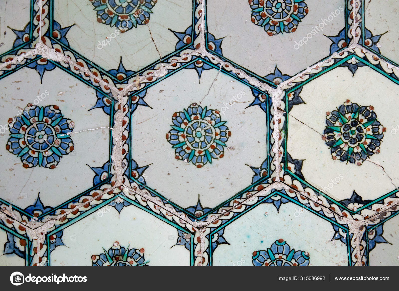 handmade old turkish blue ceramic tiles on the wall in istanbul city turkey close up ancient ottoman patterned iznik syle design tile composition flower patterns on ceramic tiles stock photo image
