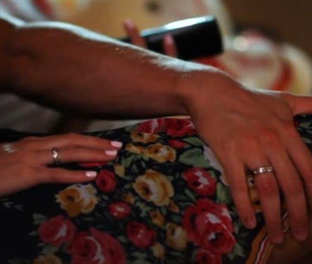 Closeup Newlyweds Sit Couch Tender Man Strokes Woman Leg Lifting Stock Video