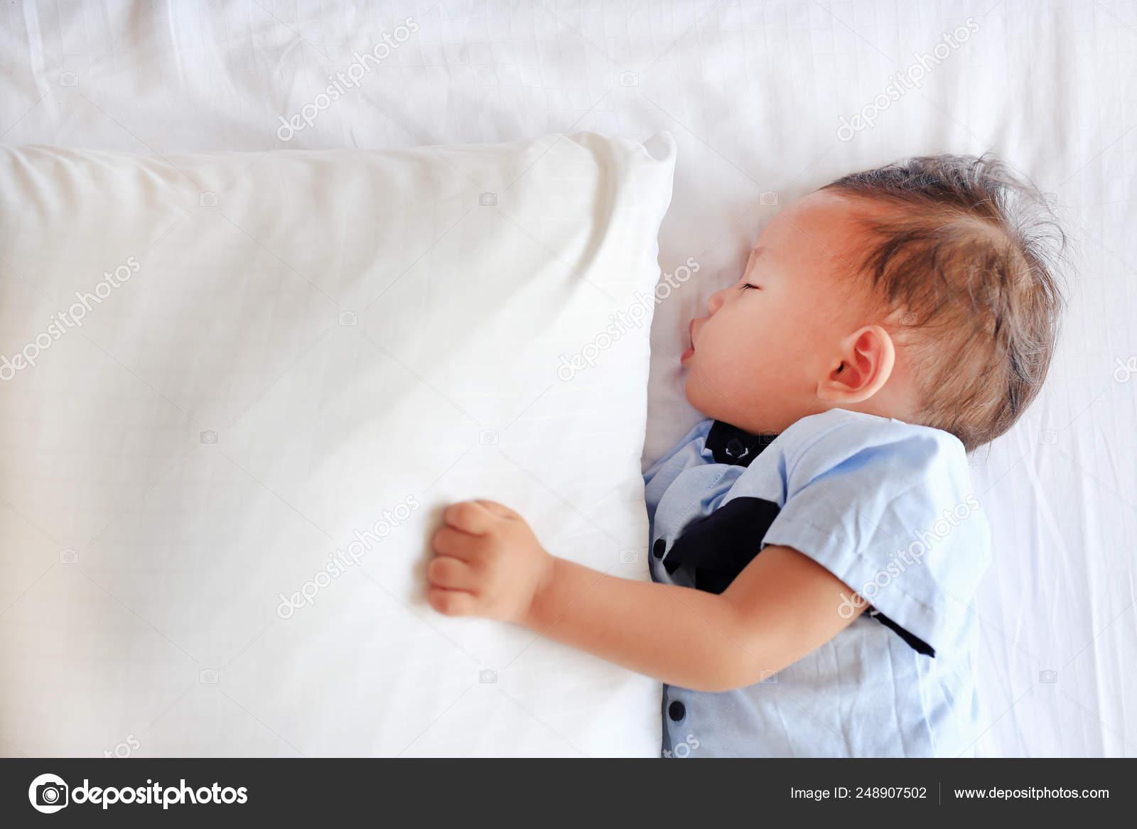 https depositphotos com 248907502 stock photo close baby boy sleeping bed html