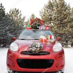 Car With Christmas Tree Wreath And Gifts In Snowy Forest On Winter Day Stock Editorial Photo C Liudmilachernetska Gmail Com 255360624