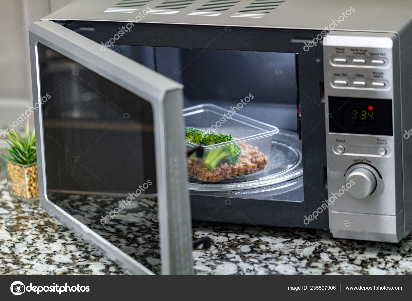 https depositphotos com 235597906 stock photo using microwave oven heat food html