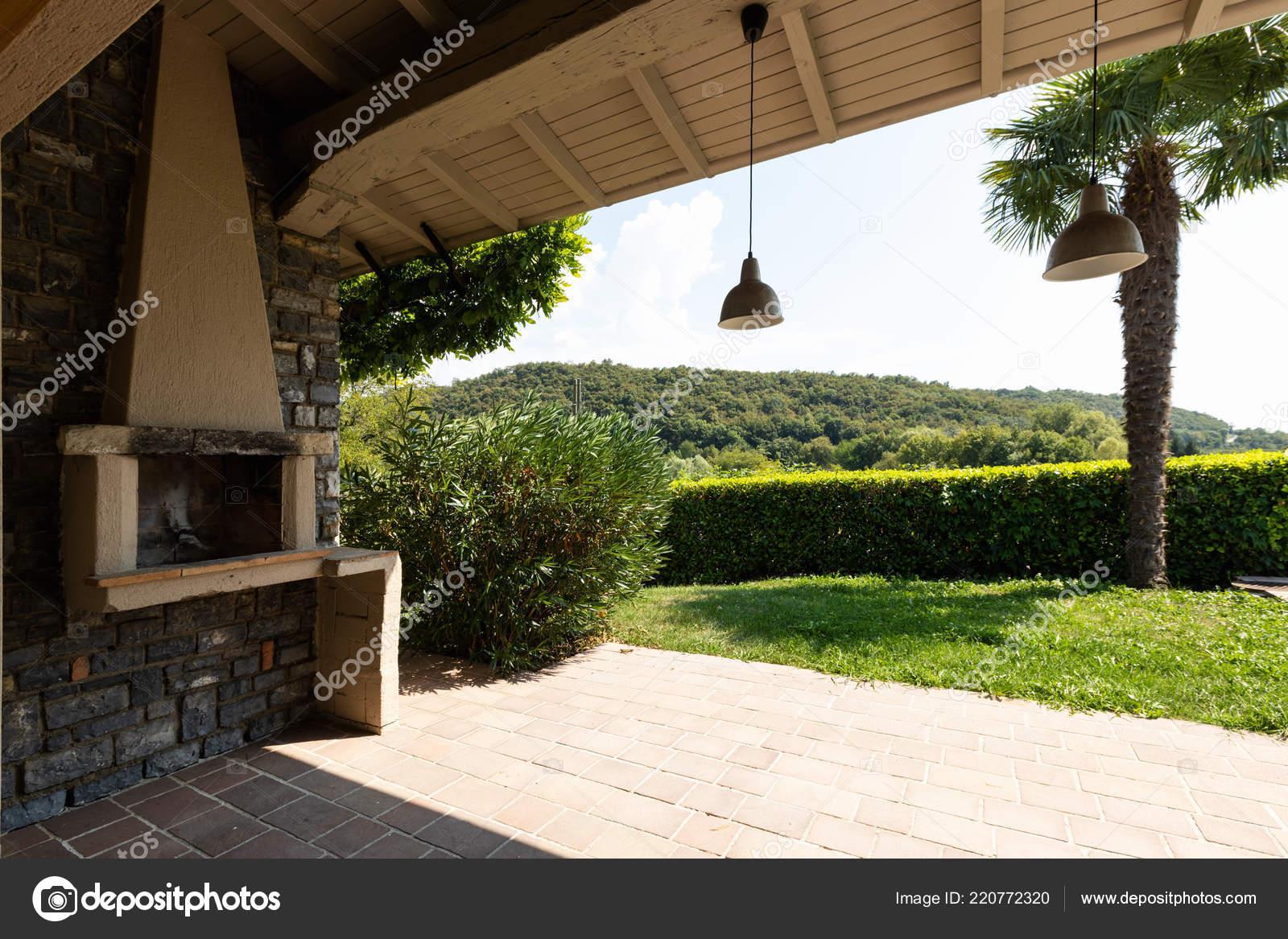 https depositphotos com 220772320 stock photo patio fireplace modern villa surrounded html