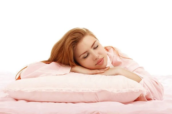 young beautiful girl sleeps in the bed