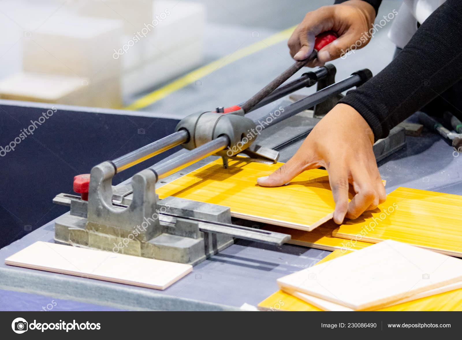 cutting floor tiles using tile cutter machine cutting ceramic tiles stock photo image by c prarinya 230086490