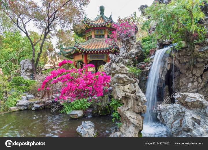 pavilion and waterfall in oriental garden in hong kong