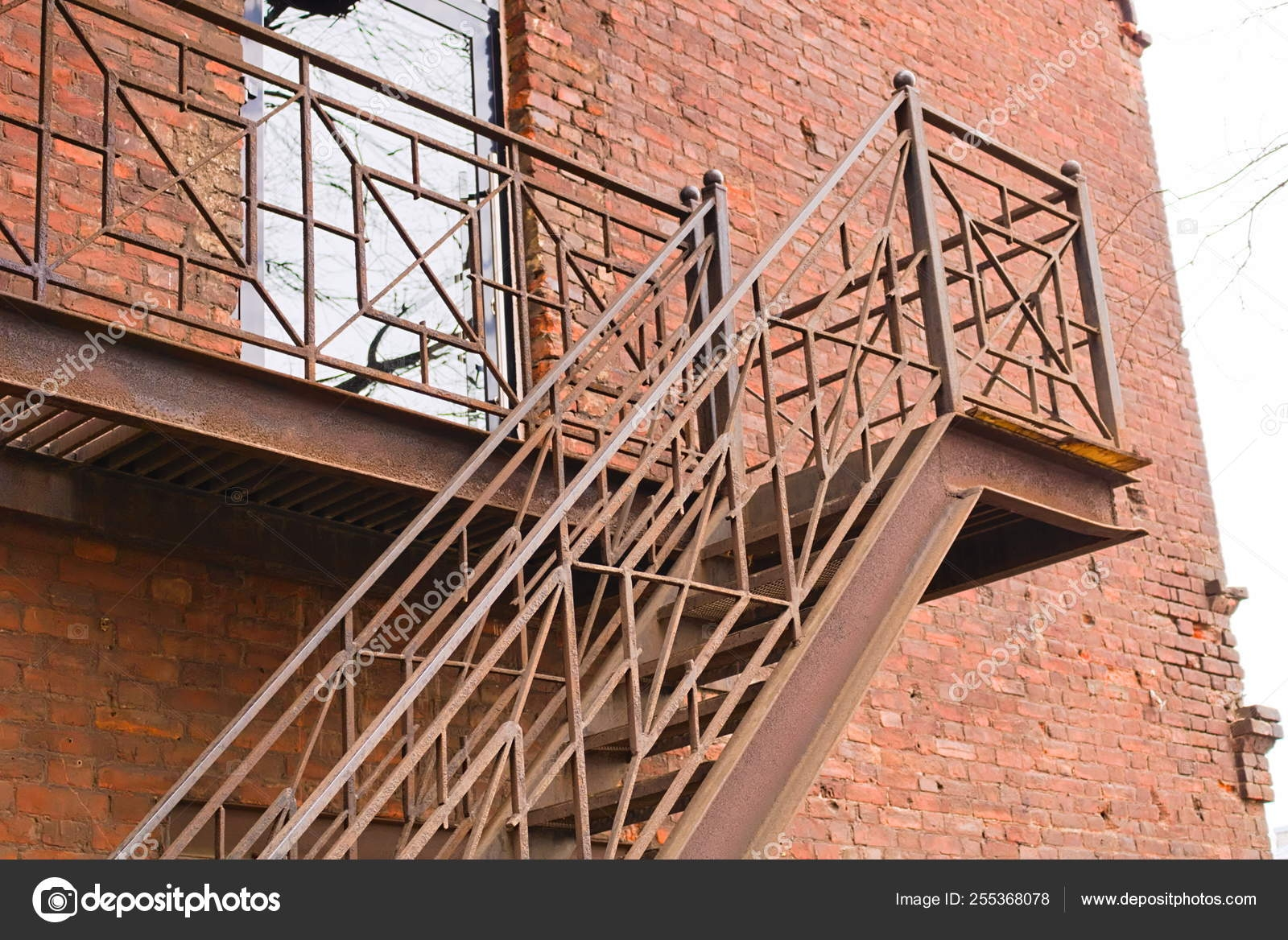 Fire Escape Stairs View From Below — Stock Photo © Linchk 255368078   Metal Steps For Outside   Loading Dock   Covered   Round   Easy   Outdoors